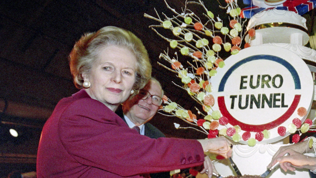 "Margaret Thatcher cuts cake inscribed ""Euro Tunnel"""
