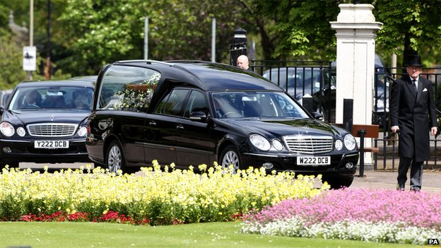A hearse carrying the coffin of author Sue Townsend arrives at the De Montfort Hall, Leicester, for her funeral service