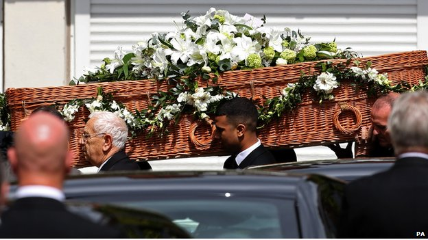 The coffin of author Sue Townsend leaves the De Montfort Hall following her funeral service in Leicester city centre