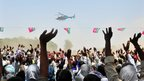 People waves as Uttar Pradesh's Chief Minister Akhilesh Yadav's  helicopter leaves an election campaign rally