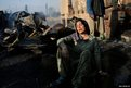 A Kashmiri woman is pictured following a fire which destroyed her home in Srinagar, India
