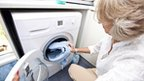 woman with washing machine