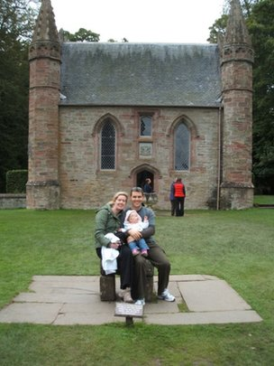 Family portrait in front of Scottish church