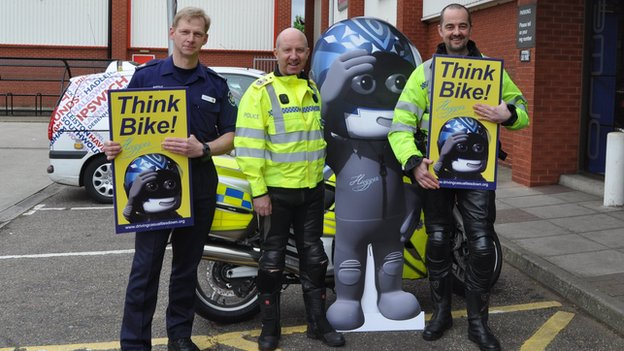 Suffolk's Chief Constable Douglas Paxton (centre) with the new Think Bike signs