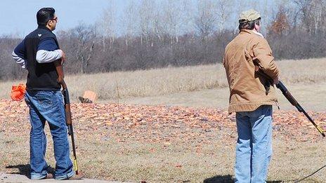 Amar Kaleka and another man at a shooting range