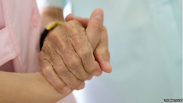 carer holding old person's hand