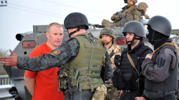 Ukrainian troops confront a pro-Russia sympathiser outside Sloviansk, eastern Ukraine, 2 May 2014