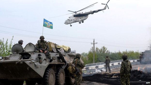 Ukrainian soldiers stand at a checkpoint they seized on the outskirts of Sloviansk - 2 May 2014