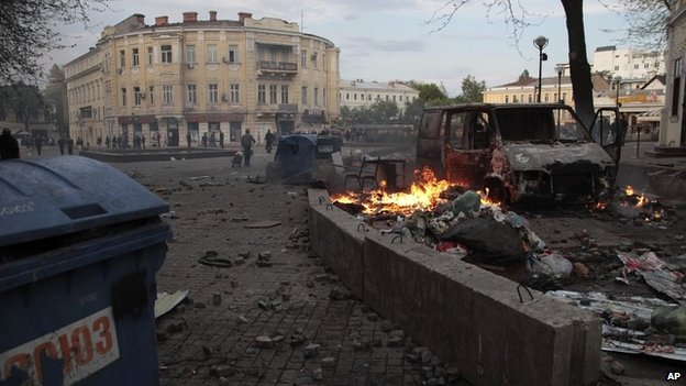Trashed items are smoldering among debris at a square following clashes in Odessa, Ukraine, on Friday - 2 May 2014