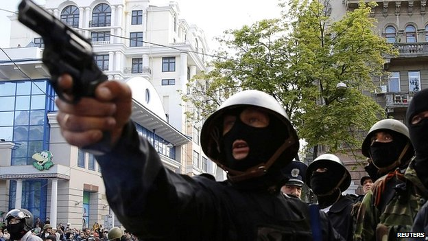 A pro-Russian aims a pistol at supporters of the Kiev government during clashes in Odessa - 2 May 2014