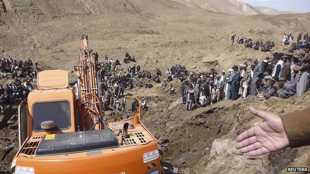 An excavator digs at the site of a landslide at the Hargu district in Badakhshan province, 3 May 2014