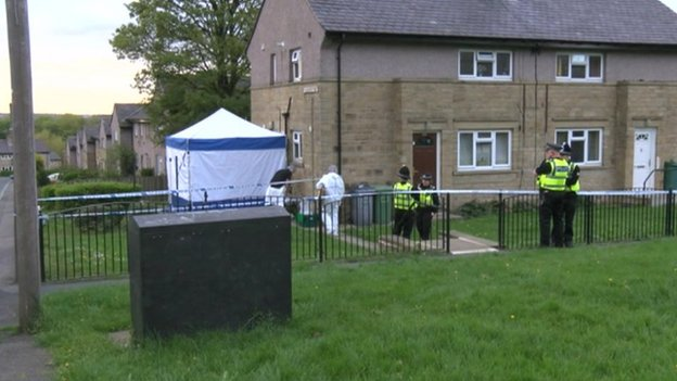 Police and forensic officers at house