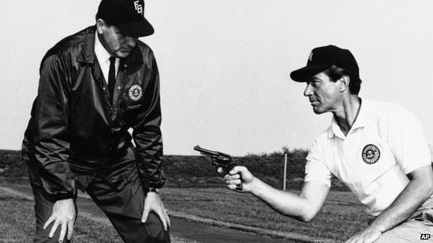 Zimbalist Jr (right) gets some training at the FBI academy for his role in The FBI, 1965