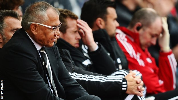 Fulham manager Felix Magath (left)