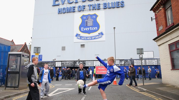 Children play outside Goodison Park ahead of Everton v Manchester City