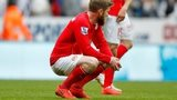Cardiff's Aron Gunnarsson is left dejected after his side's relegation