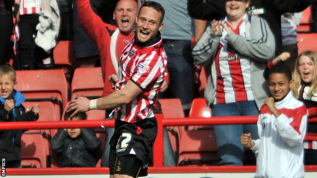 Ben Davies celebrates his winning goal for Sheffield United against Coventry City.