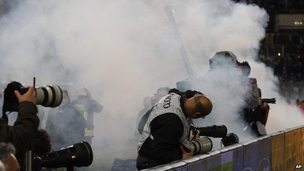 Smoke from flares thrown by supporters during the Italian cup final, 3 May 2014