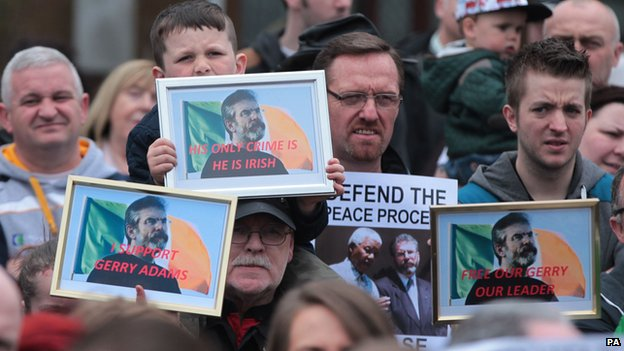 "People holding ""release Gerry Adams"" posters"
