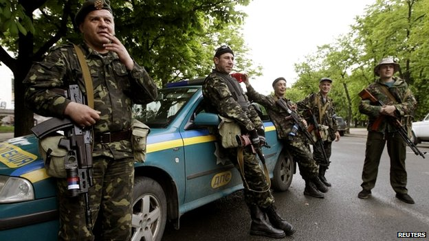 Pro-Russian gunmen stand near the seized regional government headquarters in Luhansk - 3 May 2014
