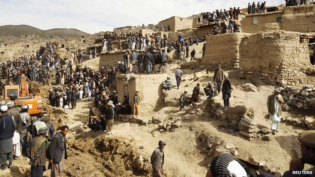 Afghan villagers gather at the site of a landslide at the Argo district in Badakhshan province, - 3 May 2014