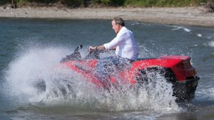 Jeremy Clarkson enters the ocean on a quad bike