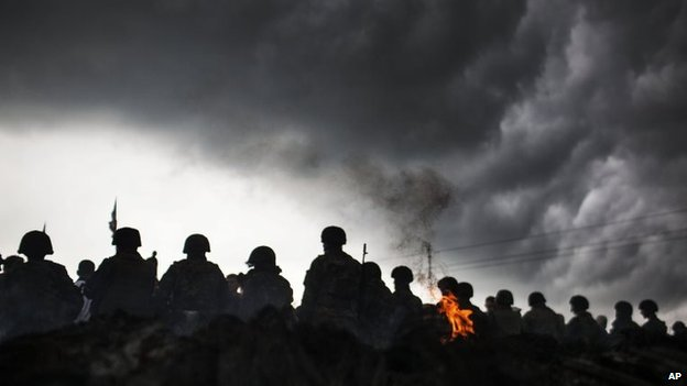 Ukrainian Army soldiers line up in front of Pro-Russia civilians who where blocking the road in the Andreevka, Ukraine, 2 May 2014