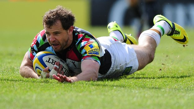 Harlequins stand-off Nick Evans celebrates the second of his side's four tries at Sandy Park
