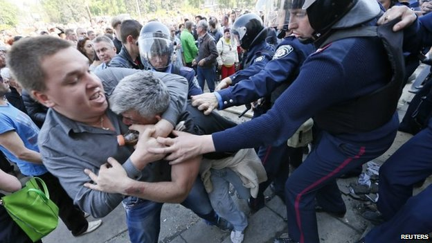 Men clash as members of Ukrainian Interior Ministry security forces approach to separate them during a rally outside a trade union building, where a deadly fire occurred, in Odessa 3 May 2014