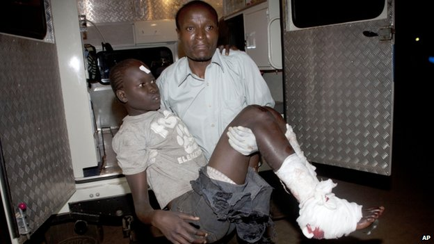 An injured child arrives in an ambulance at Kenyatta National Hospital, Nairobi, on 4 May  2014.