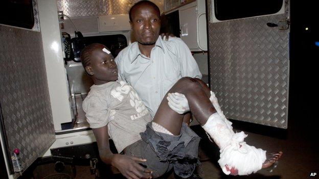 An injured child arrives in an ambulance at Kenyatta National Hospital, Nairobi, on 4 May  2014.