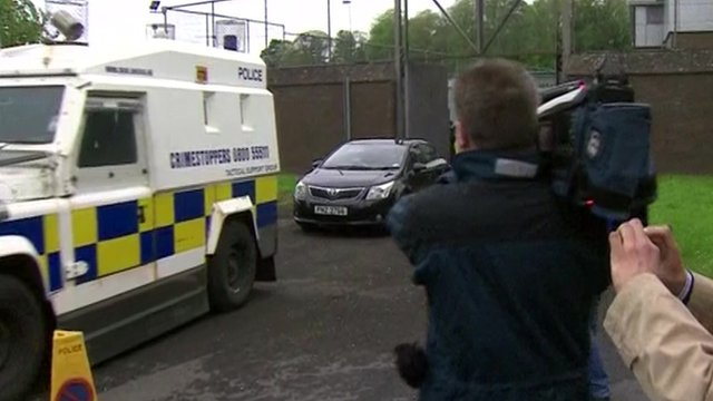 Gerry Adams leaving Antrim PSNI station
