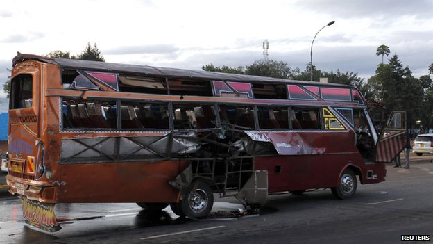A bus damaged after an explosion is seen along the Thika super-highway in Kenya's capital Nairobi, on 4 May 2014.