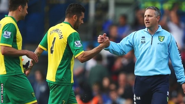 Neil Adams congratulates his Norwich players