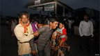 Villagers from Muslim communities wail upon seeing the body of a relative at a relief camp in  in Baksa district in the Indian state of Assam.