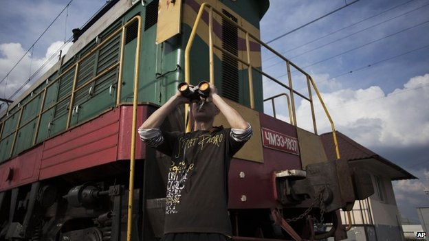 A pro-Russian observes Ukrainian military positions from a train station under rebel control south of Sloviansk - 4 May 2014