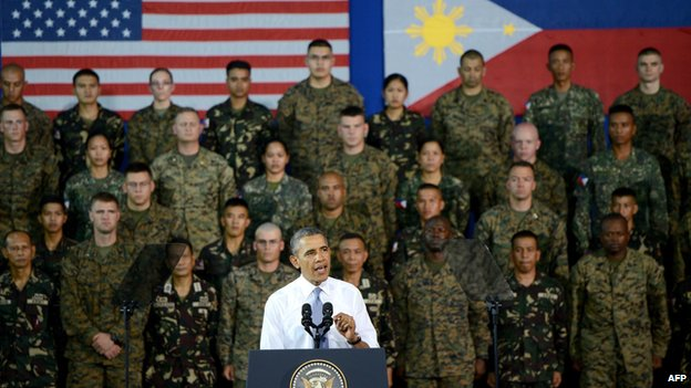 US President Barack Obama delivers remarks to US and Philippine troops at Fort Bonifacio in Manila on April 29, 2014. Obama delivered a fresh warning on April 29 to China against using force to resolve territorial disputes, as he pledged 'ironclad' military support for the Philippines.