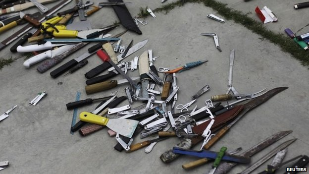 Bladed weapons lie on the ground outside the maximum security prison in Tamara on the outskirts of Tegucigalpa on 25 February, 2014