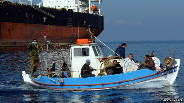 Immigrants arrive at the port of Chania on the island of Crete on 1 April 2014