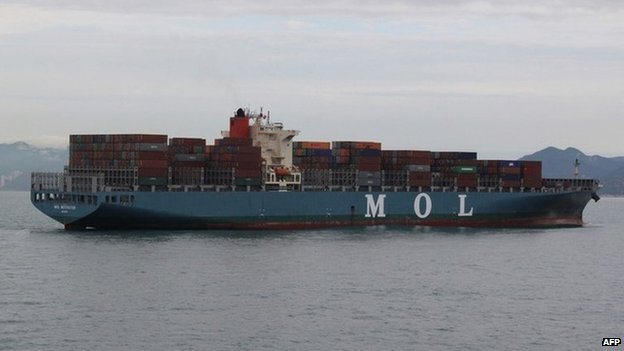 This handout photo taken and received by the Nanhai Rescue Bureau on 5 May 2014 shows the Marshall Islands-registered MOL Motivator floating in the waters off Hong Kong after it collided with a Chinese cargo ship, the Zhong Xing 2
