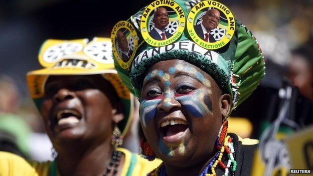 Supporters of South Africa's President Jacob Zuma's African National Congress (ANC) cheer during their party's final election rally in Soweto, on 4 May 2014