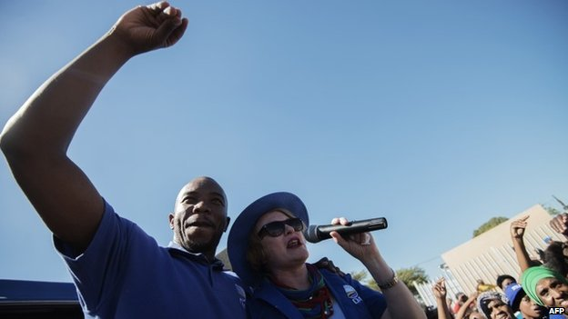 South African opposition party Democratic Alliance (DA) president Helen Zille and DA Gauteng Premier candidate Musi Maimane (L) address a crowd of supporters during an elections campaign rally in Johannesburg Alexandra township on 30 April 2014