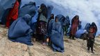 Afghan villagers near the scene in the landslide-hit Aab Bareek village in Argo district of Badakhshan