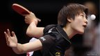 Ding Ning of China serves against Yuka Ishigaki of Japan during their final match of the World Team Table Tennis Championships in Tokyo