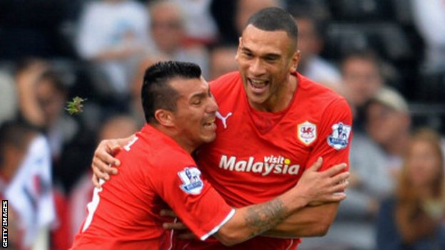 Gary Medel and Steve Caulker celebrate a Cardiff goal
