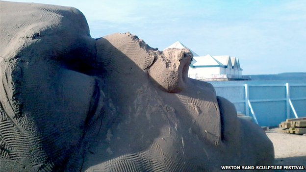 A damaged sculpture at the Weston Sand Sculpture Festival