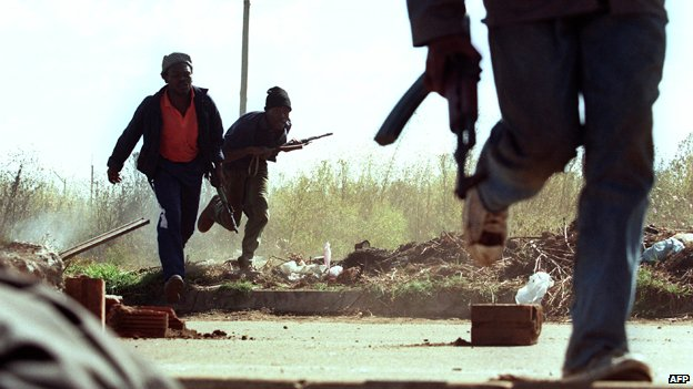ANC supporters run for cover in Thokoza in 1994