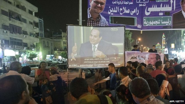 Egyptians watch Abdel Fattah al-Sisi interview on big screen