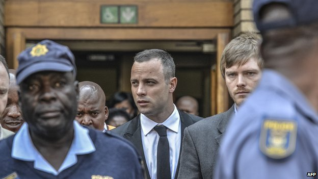 South African paralympic Oscar Pistorius leaves court in Pretoria on on 5 May  2014.