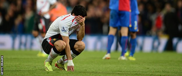 Suarez is dejected as Liverpool's title chances take a major hit